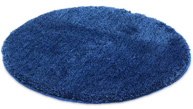 Blå rund badrumsmatta.