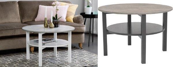 Ett mörkt och ett vitt soffbord med ljusgrå laminatskrivor i mönster av betong.